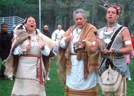 Wampanoags in regalia at celebration of ancient fish weir, Boston Common, 2005. Photo by Maggie Holtzberg.
