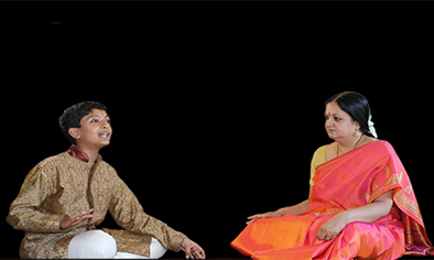 Tara Anand Bangalore (right) and Pratik Bharadwaj on stage, Carnatic singing, 2015; Framingham, Massachusetts;