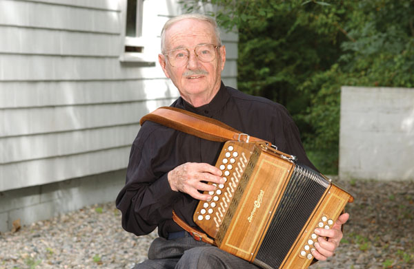 Joe Derrane outside his home, Musician, 2006; Joe Derrane (b. 1930); Randolph, Massachusetts; Photography by Tom Pich