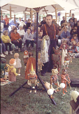 Puppeteer Dusan Petran demonstrating his puppets' abilities, Ethnic festival, 2001; Eastern European Festival; Deerfield, Massachusetts; Photography by Kate Kruckemeyer