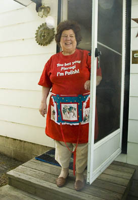 Dottie Naruscewicz Flanagan standing in her doorway, Polish Pierogi, 2011; Dorothy Naruscewicz Flanagan; Lowell, Massachusetts; Photography by Maggie Holtzberg