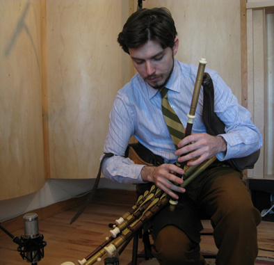 Joey Abarta playing the uilleann pipes, Irish musician, 2014; Roxbury, Massachusetts;