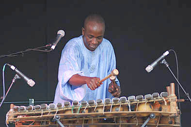 Balla Kouyaté with balafon. Photography by Alison Williams., Malian musician, 2007; Balla Kouyaté; Medford, Massachusetts;
