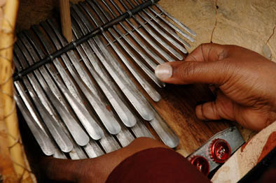 Playing the mbira. Photography by Jeff Crandall, Musician, 2008; Solomon Murungu; Bolton, Massachusetts;