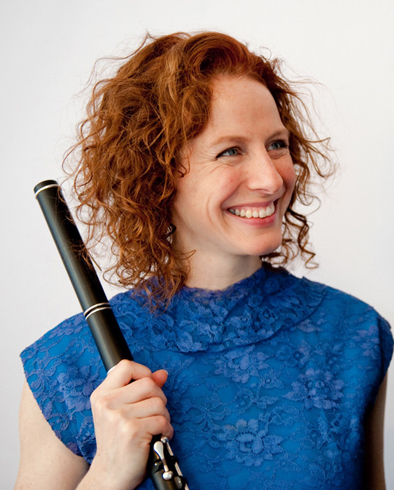 Shannon Heaton holding flute., Irish flute and tin whistle player, 2016; Shannon Heaton; Medford, Massachusetts;