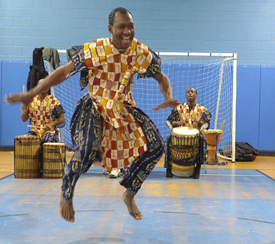 Sidi Joh Camara performing, West African dance and drumming, 2017; Sidi Mohammed Camara; Dorchester, Massachusetts;