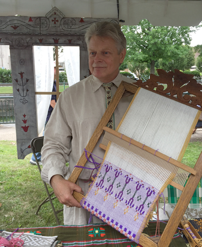 Jonas Stundzia holding a frame used in pick-up weaving, Lithuanian pick-up weaving, 2015; Jonas Stundzia; Lowell, Massachusetts; Photography by Maggie Holtzberg