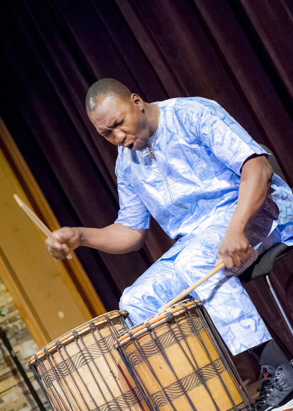 Sidi Joh Camara drumning at the Shalin Liu Performance Center; West African dance; 2017: Rockport, Massachusetts