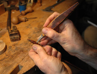 Close up of chiseling out mortise; bow maker; 2011; David Hawthorne; Cambridge, Massachusetts; wood, ivory, metal thread