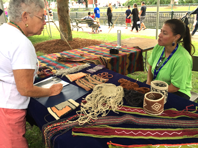 Elizabeth James Perry demonstrating her work at the 2015 Lowell Folk Festival; Wampanoag woven textiles; 2013: Lowell, Massachusetts