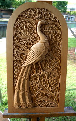 Peacock carving on display at the 2013 Lowell Folk Festival; Architectural and figurative woodcarving; 2013: Hampden, Massachusetts