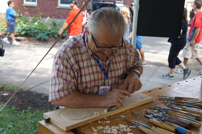 Dimitrios Klitsas demonstrating at the 2013 Lowell Folk Festival; Architectural and ornamental woodcarving; 2013: Lowell, Massachusetts