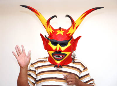 Angel Sánchez Ortiz wearing devil mask; Apprenticeship - Puerto Rican carnival mask making; 2006: Springfield, Massachusetts; Painted papier mâché