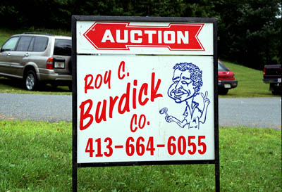 Sign announcing Rowe Old Home Days  auction; Musician and auctioneer; 2005: Rowe, Massachusetts