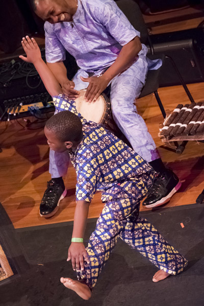 Tiemoko dancing while Joh drums at Shalin Liu Performance Center; West African Dance; 2017: Rockport, Massachusetts